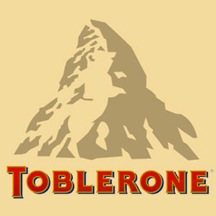 "There is a dancing bear above the ""BLE"". Toblerone chocolate bars originated in Berne , Switzerland , whose symbol is the bear. It features the animal on its flag and coat-of-arms."